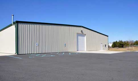 Red Iron Commercial Building With Metal Panels